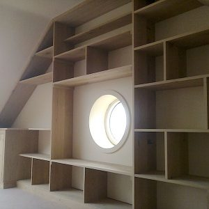 Bespoke Oak Shelving And Desk Framing Bullseye Window