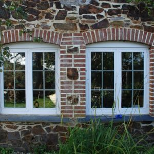 New Window Openings With Brick Reveals Slate Sills